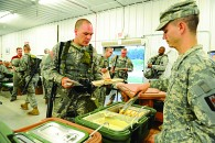 Soldiers from the 338th Engineer Company are served a hot meal at Contingency Operating Location Freedom at Fort McCoy, Wis., as part of a food tasting test.