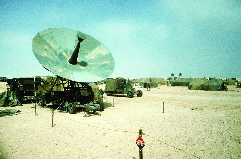 A portable satellite dish is set up in the VII Corps command and control ramp area during Operation Desert Storm.