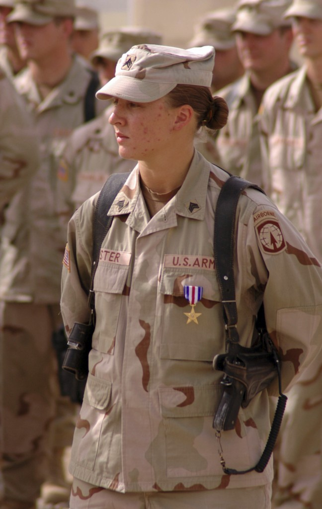 Sgt. Leigh Ann Hester, vehicle commander, 617th Military Police Company, Richmond, Ky., stands at parade rest after receiving the Silver Star at an awards ceremony at Camp Liberty, Iraq, June 16, 2005. Hester is the first female Soldier serving in Operation Iraqi Freedom to receive the Silver Star. (U.S. Army photo by Spc. Jeremy D. Crisp.)