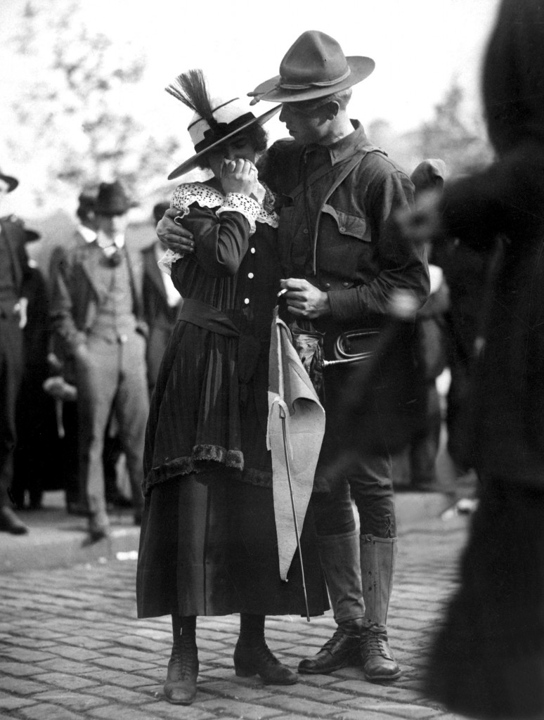 A soldier boy of the 71st Regiment Infantry, New York National Guard, saying good bye to his sweetheart as his regiment leaves for Camp Wadsworth, Spartanburg, S.C., where the New York Division trained for service. 1917. IFS. (War Dept.) Exact Date Shot Unknown NARA FILE #: 165-WW-476-21 WAR & CONFLICT BOOK #: 461