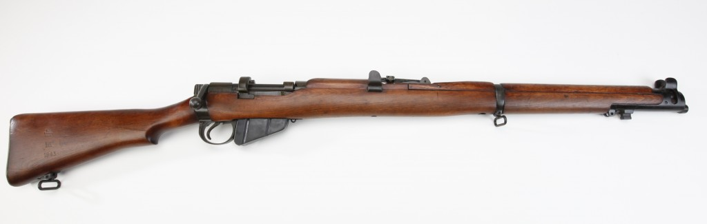 The workhorse of the British Army, the Short Magazine Lee Enfield could be fired so quickly that at the battle of Mons in 1914, German troops thought they were under machine gun fire.1942/43 British S.M.L.E. No. 1 Mark III Bolt-Action Box-Magazine Rifle (repeater/ breech-loading/ smokeless powder/ cartridge ammunition) Used in both World Wars, the Short Magazine, Lee Enfield No. 1 remained particularly popular with Canadian forces. Actually adopted in 1907, the improved Mark III served well in jungle and in desert warfare applications, where it was used extensively. Like the Germans, the British did not adopt a semi-automatic rifle for primary use in the Second World War. This was due mostly to the unavailability of sufficient factory space and production capacity. Therefore, most semi-autos that were used by the British came from the United States. In the main, the Mark III proved to be very satisfactory, particularly when supported with fire from machine guns. --Dr. William L. Roberts, THE AMERICAN LIBERTY COLLECTION; #143 The British government armory at Enfield Lock, Middlesex, was founded in 1804 to assemble Brown Bess muskets for use by the country's military forces. As with the U.S. armories at Springfield, Massachusetts and Harpers Ferry, Virginia, this location was chosen due to its proximity to a waterway that provided both a power source and transportation for this facility. A plentiful supply of walnut trees in the area near Enfield Lock became a ready source for musket stocks. Initially, musket parts were manufactured by private concerns and cottage industries in London and Birmingham. Interchangeability of parts and quality control were both sadly lacking under this arrangement. As the century progressed, so did technology. British ordnance officers had been considering possible replacements for the smoothbore Brown Bess, which had been the standard infantry arm for over 100 years. In 1823, the Royal Enfield Manufactory received an order for 5,000 Bake