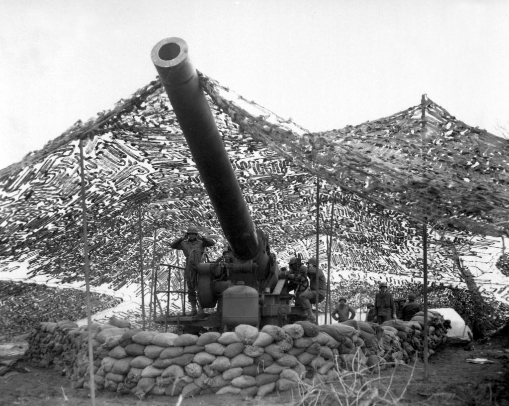 "Front view of 240mm howitzer of Btry. ""B"", 697th F.A. Bn., just before firing into German held territory. Magnano area, Italy. January 30, 1944. Boyle. (Army) NARA FILE #: 111-SC-187126 WAR & CONFLICT BOOK #: 1028"