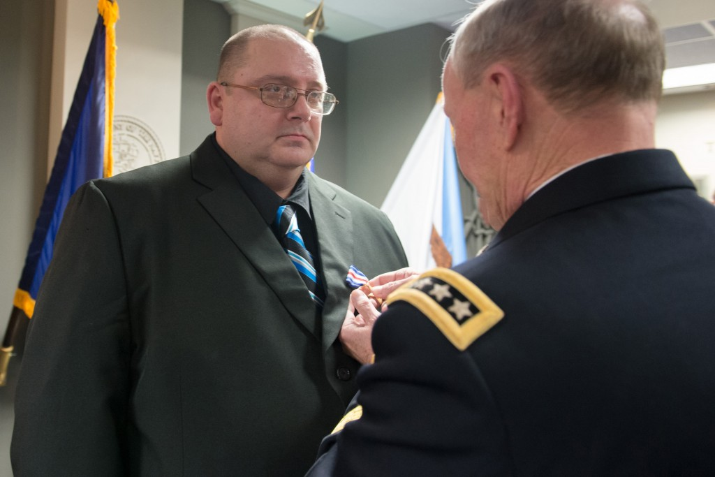 General Martin E. Dempsey, Chairman of the Joint Chiefs of Staff, presents former Private First Class Mark Deville with the Silver Star at a ceremony at the Pentagon, 28 January 2014, nearly thirty years after the JSA firefight. (Department of Defense photograph by Petty Officer First Class Daniel Hinton)