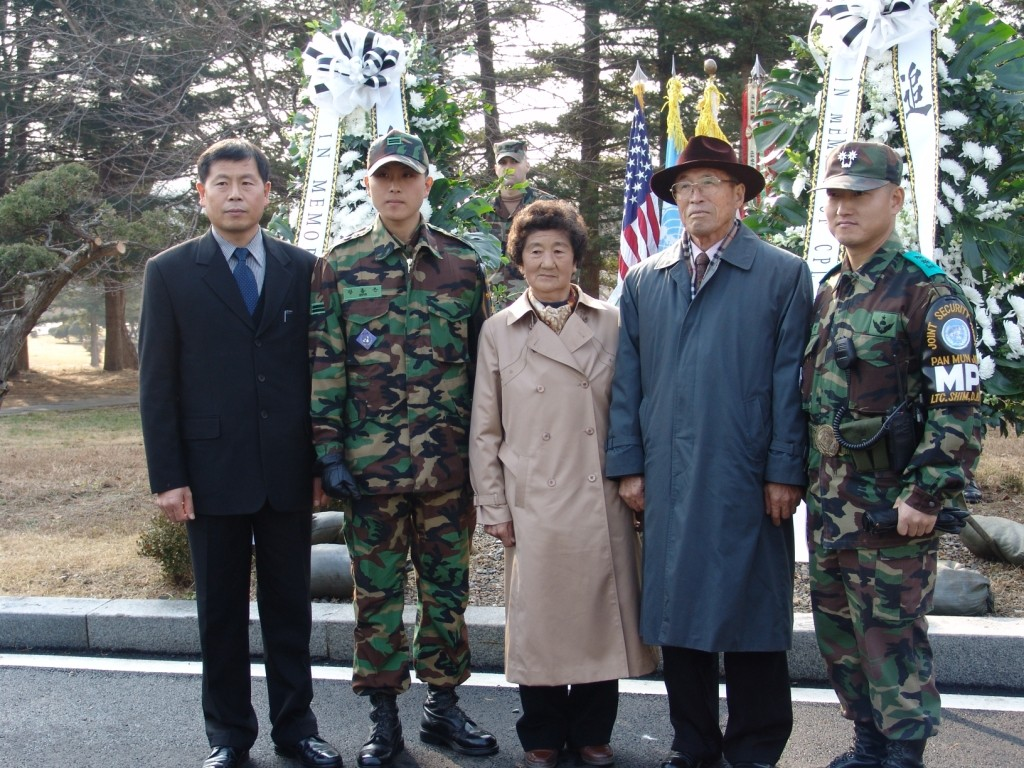 The brother, nephew, and parents of Corporal Jang Mong-ki attend a memorial at the site of Corporal Jang's death, 23 November 2005. Jang was the only UNC soldier killed in the JSA firefight. (Author's collection)