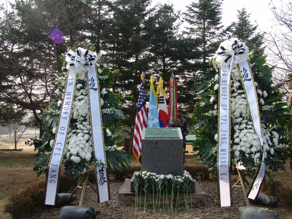 """This photograph shows memorial wreaths provided by the Republic of Korea's 1st Infantry Division and the JSA """"Old Boys"""" Association, 23 November 2005. (Author's collection)"""