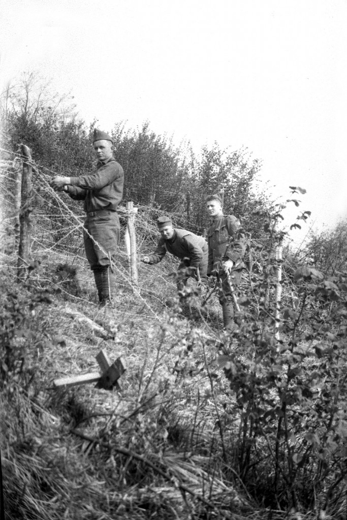 Soldiers from the 103d Infantry string wire in a training area in France in the spring of 1918. (Maine National Guard Archives)