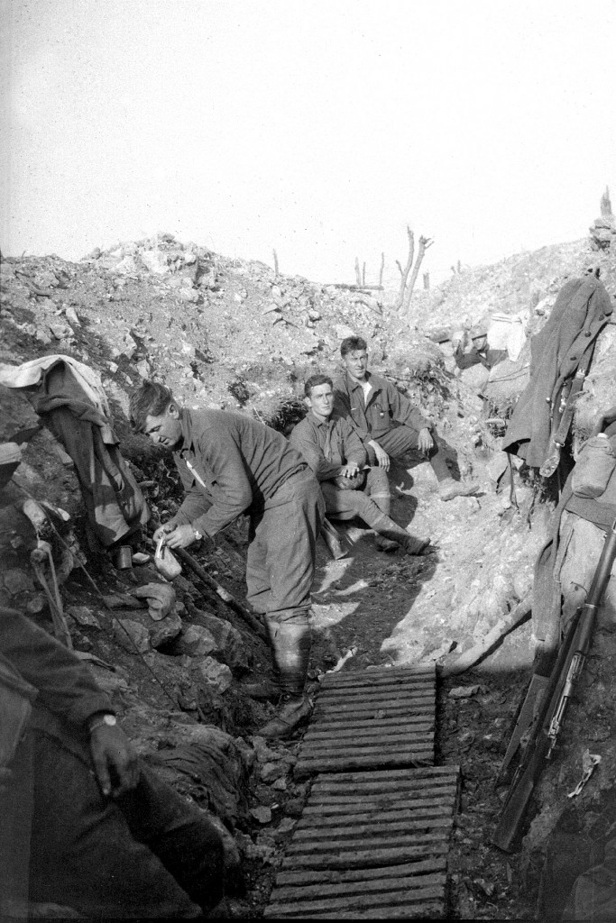 Elements of the 103d Infantry began rotating into the tranches along quiet sectors beginning in the spring of 1918. In this photograph, doughboys pose for a photograph while manning a section of trench. (Maine National Guard Archives)