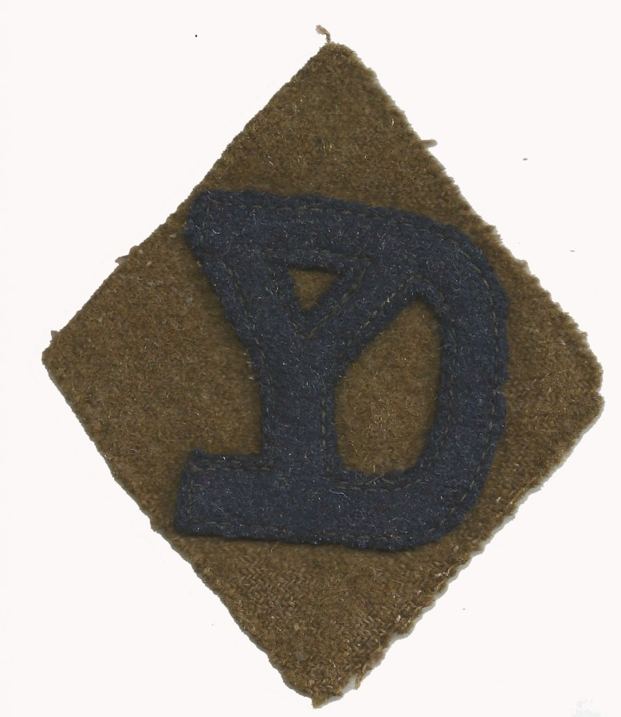 World War I marked the first time U.S. soldiers wore shoulder sleeve insignia to identity the unit in which they served. Here is an example of the 26th Division shoulder patch. (David Kaufman Collection)
