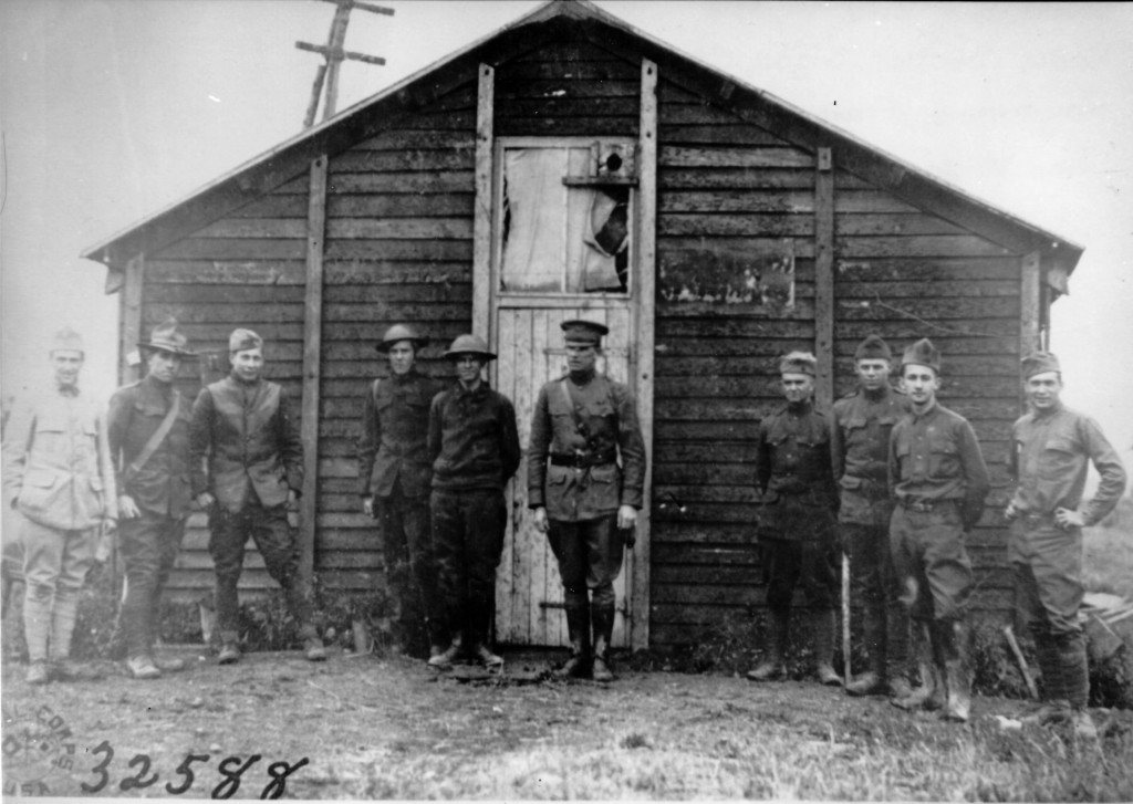 Soldiers stand in front of Aero Intercept Station Number 81 at Royaumeix, 14 June 1918. Aero intercept stations collected messages sent by enemy aircraft and passed alerts to American and French pursuit squadrons. (National Archives)