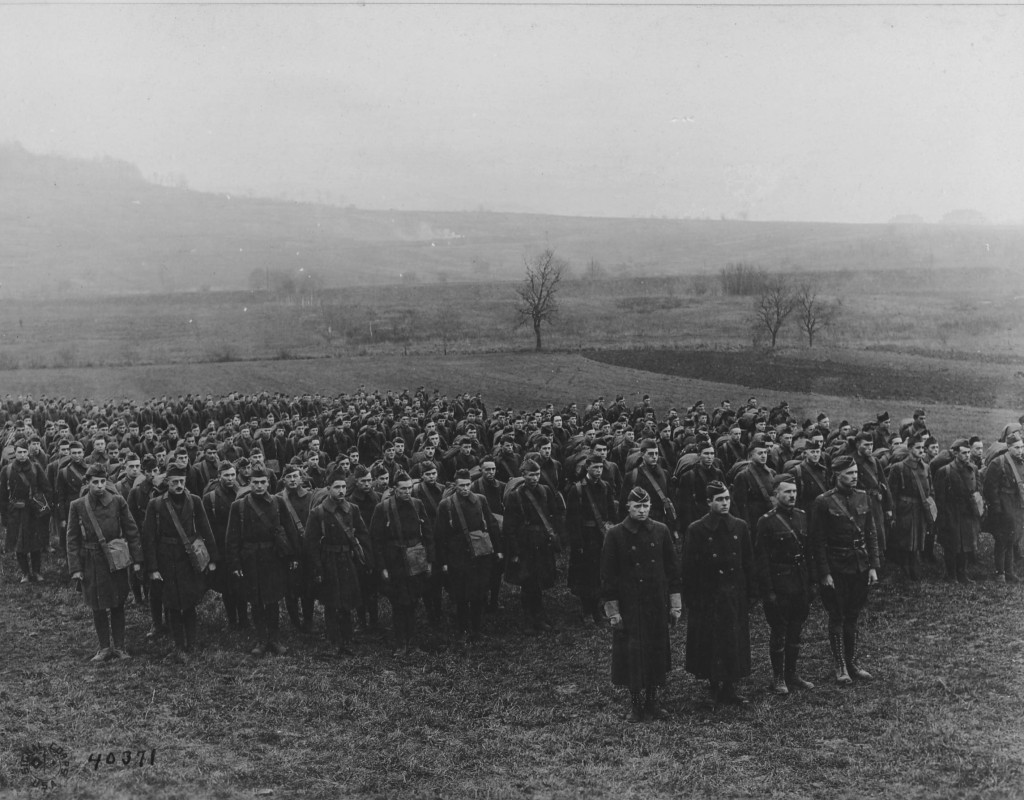 Officer s and enlisted men of the AEF Signal Corps Radio Section gather for a photograph after the Armistice, 1 December 1918. Major Loghry is on the left of the first row. (National Archives)